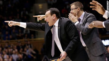Duke head coach Mike Krzyzewski directs his team during the second half of an NCAA college basketball game against Stephen F. Austin in Durham, North Carolina.