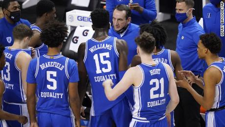 Duke head coach Mike Krzyzewski, top, talks to his team during the first half of an NCAA college basketball game against Louisville on Wednesday, March 10, 2021.