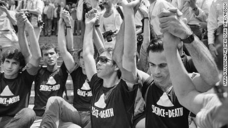 Demonstrators in New York in 1987 hold hands during a moment of silence while demanding more government action in the fight against AIDS.