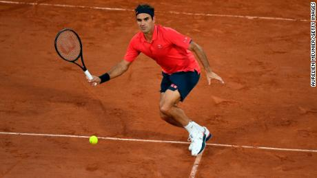 Federer plays a forehand during his third round match against Dominik Koepfer at Roland Garros on 5 June.