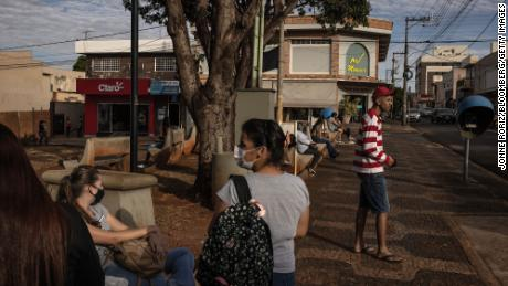 People gather at a park in Serrana, Brazil, on Wednesday, May 26, 2021.