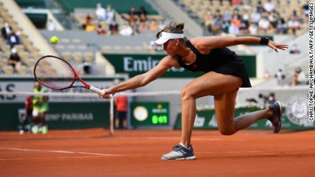 Elena Rybakina returns the ball to Serena Williams of the United States during the women's singles fourth round match.