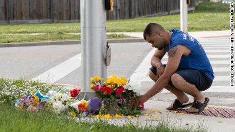 A man brings flowers and pays his respects at the scene in London, Ontario on June 7, 2021.