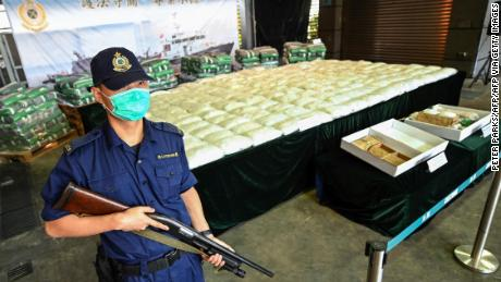 An armed customs officer guards a record seizure of over 500 kilograms of methamphetamine during a news conference in Hong Kong in November.