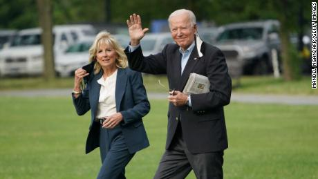 US President Joe Biden and First Lady Jill Biden make their way aboard Marine One before departing The Ellipse near the White House on June 9, 2021 in Washington, DC.
