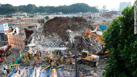 Firefighters search for survivors in Gwangju, on June 9, 2021.