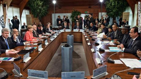 G7 leaders and outreach guests including Germany's Chancellor Angela Merkel (2-R) and United States President Barack Obama (2-L) attend a working session with at the summit of G7 nations at Schloss Elmau on June 8, 2015 near Garmisch-Partenkirchen, Germany.