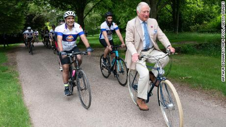 """It's the Prince of Wheels (come on, let us have that one). Sorry, obviously we mean the Prince of Wales, who hopped on a bike with members of the British Asian Trust for a short ride to kick off the charity's """"Palace on Wheels"""" cycling event at Highgrove on Thursday in Tetbury, England."""