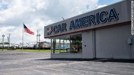 A car dealership stands empty in Laurel, Maryland.