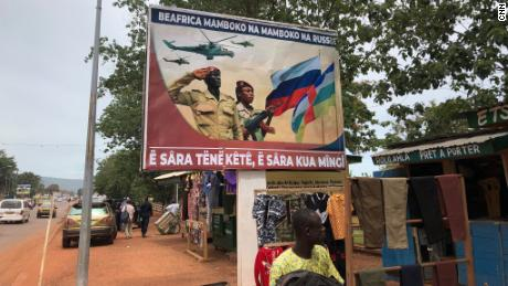 """A billboard with Russian propaganda is seen in Bangui. The message reads: """"Russia hand in hand with the Central African Republic, talk a little, work a lot."""""""