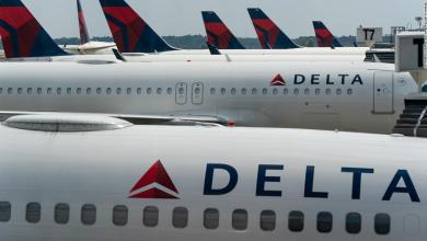 Off-duty flight attendant allegedly choked a crew member and claimed to be seated next to a terrorist before being subdued, police report says