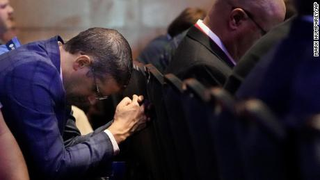 A man prays during the executive committee plenary meeting at the Southern Baptist Convention's annual meeting Monday, June 14, 2021, in Nashville, Tennessee.