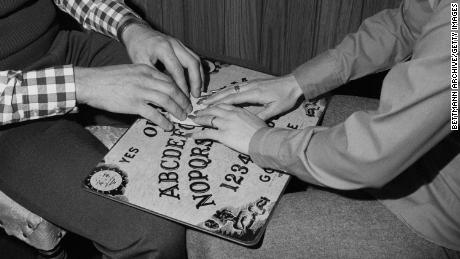 After mass tragedies such as wars many Americans have turned to Ouija boards in an attempt to contact departed loved ones.