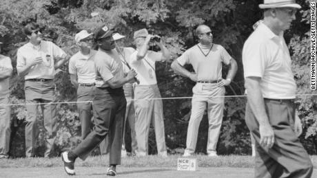 Sifford practices on the range.