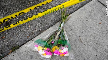 Flowers lie at the scene of the incident.