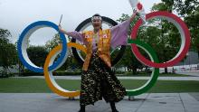 """Ishikawa performs a traditional Japanese cheer dance called the """"sansan'nanabyōshi"""" -- a routine usually performed at high school sports events to cheer on athletes."""