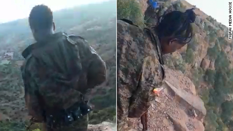 New video of Ethiopia's massacre shows soldiers passing around the phone to document their executions of unarmed men