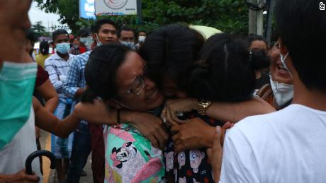 A man is hugged by two women after being released from Insein Prison in Yangon, Myanmar, on June 30.