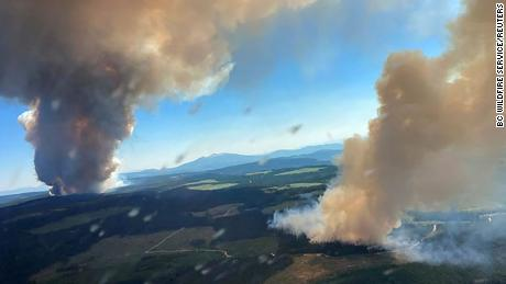 Smoke rises from a fire at Long Loch and Derrickson Lake in Central Okanagan in Canada on June 30.