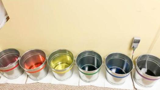 To keep track of each humidifier's output during our pump hose test, we used colored powdered dye.