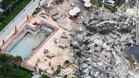 This aerial view shows search and rescue personnel working on site after the partial collapse of the Champlain Towers South in Surfside, Florida, on June 24, 2021.