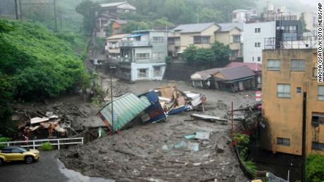 Houses are damaged by mudslide following heavy rain at Izusan district in Atami.