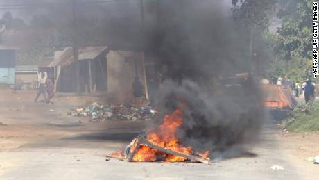 A burning barricade in the road in Mbabane, eSwatini, on June 29, 2021. Demonstrations escalated radically in eSwatini as protesters took to the streets demanding immediate political reforms.