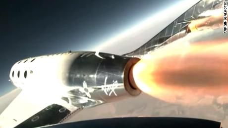 Virgin Galactic spaceplane VSS Unity rockets to outer space, with Richard Branson and crew onboard.
