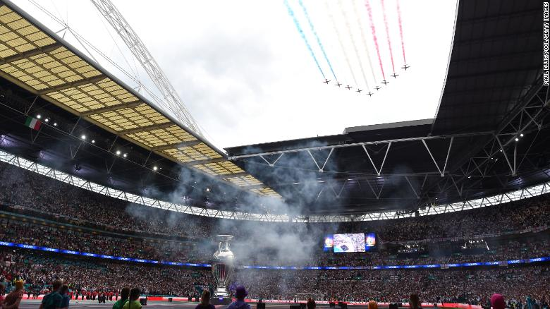 The Red Arrows fly overhead during the opening ceremony.