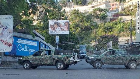 Haitian security forces' vehicles blocking the road.