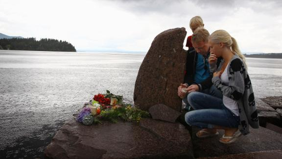 Members of the public pay their respects near Utoya Island on July 24, 2011 in Norway.