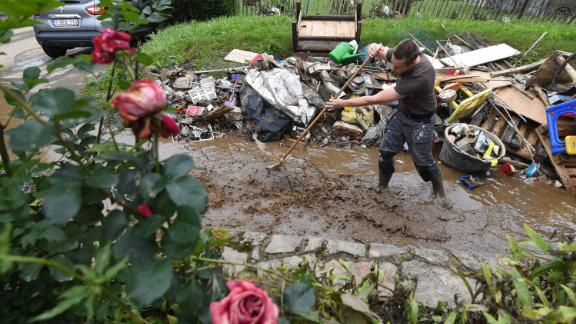 A resident stands in floodwaters in Rochefort, Belgium, on Saturday.