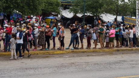 Migrants who were sent back to Mexico under Title 42 wait in line for food and supplies in a camp across the US-Mexico border in Reynosa, Tamaulipas, Mexico, on July 10, 2021.