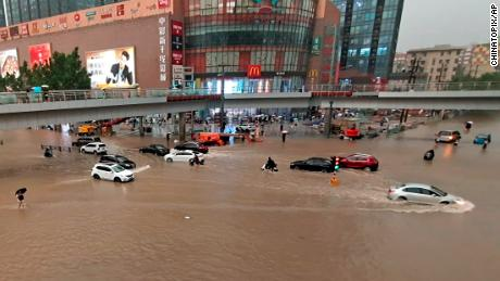 Vehicles were stranded after heavy rain on Tuesday in the city of Zhengzhou in central China's Henan province.