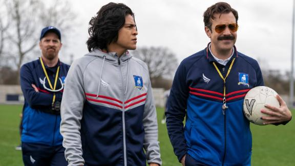 """Brendan Hunt, Cristo Fernández and Jason Sudeikis in """"Ted Lasso,"""" premiering July 23, 2021 on Apple TV+."""