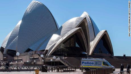 A police vehicle is seen near Sydney Opera House in Sydney, Australia, July 18, 2021.
