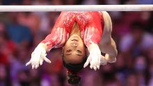 Suni Lee competes on the uneven bars during the Women's competition of the 2021 US Gymnastics Olympic Trials at America's Center on June 27, 2021.
