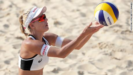 Sluková-Nausch prepares to serve against Sarah Pavan and Melissa Humana-Paredes of Canada.