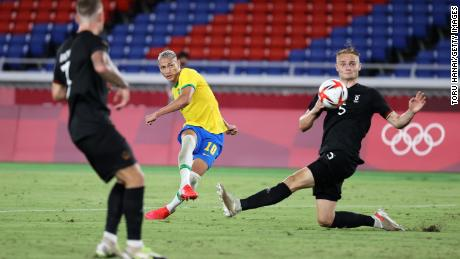 Richarlison (#10) scores Brazil's third goal during the men's first round Group D match against Germany during the Tokyo 2020 Olympic Games at the International Stadium Yokohama on July 22, 2021 in Yokohama, Tokyo, Japan. .
