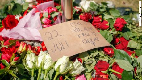"""Floral tributes lie outside Oslo Cathedral on Thursday on the 10-year anniversary of the July 22, 2011 terrorist attacks -- commonly referred to in Norway as """"22 Juli."""""""
