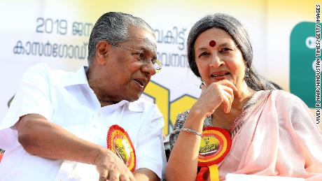 """Chief Minister Pinarayi Vijayan """"women's wall"""" with a worker during protests in 2019"""