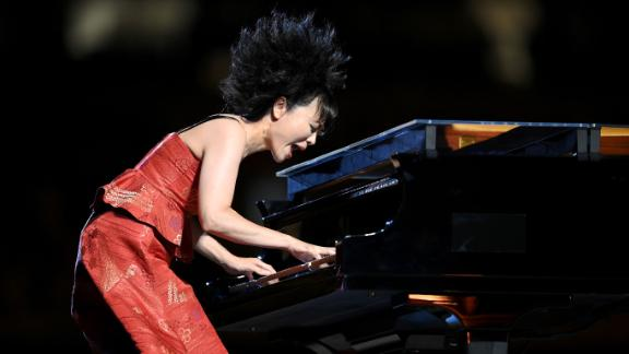 Japanese jazz composer Hiromi Uehara plays the piano during the opening ceremony.
