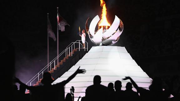 Japanese tennis star Naomi Osaka lights the Olympic cauldron at the end of the opening ceremony on Friday, July 23.