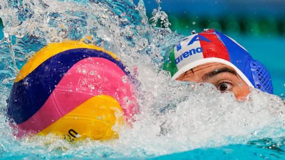 Italy's Alessandro Velotto moves the ball during a water polo match against South Africa on July 25.