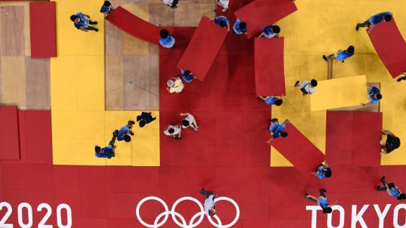 Staff members prepare for judo competition at the Budokan arena in Tokyo.