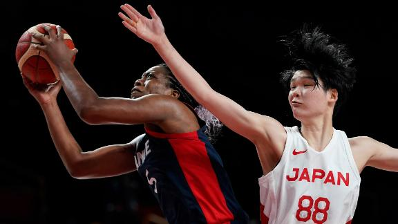 France's Endy Miyem is defended by Japan's Himawari Akaho during a basketball game on July 27. Japan defeated France 74-70.