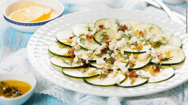 Zucchini carpaccio is prepared here with feta, walnut and dill.