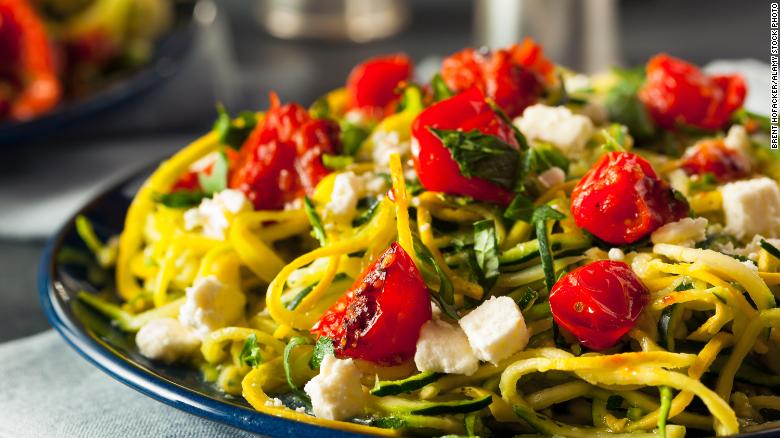 Zucchini noodle pasta is served here with tomatoes and feta.