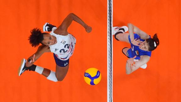 American Haleigh Washington, left, spikes the ball during a volleyball match against China on July 27. The United States won in straight sets, 29-27, 25-22, 25-21.