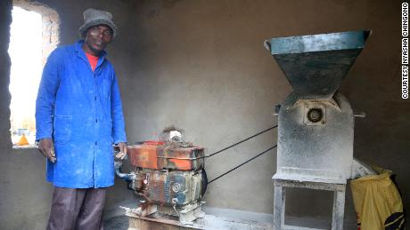 Alfred Makumbe in his grinding mill.  His business has been affected by Kovid.